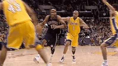 Retro GIF: Vince Carter Reverse 360 lay up against the Lakers - http://nbafunnymeme.com/nba-gif-2/retro-gif-vince-carter-reverse-360-lay-up-against-the-lakers