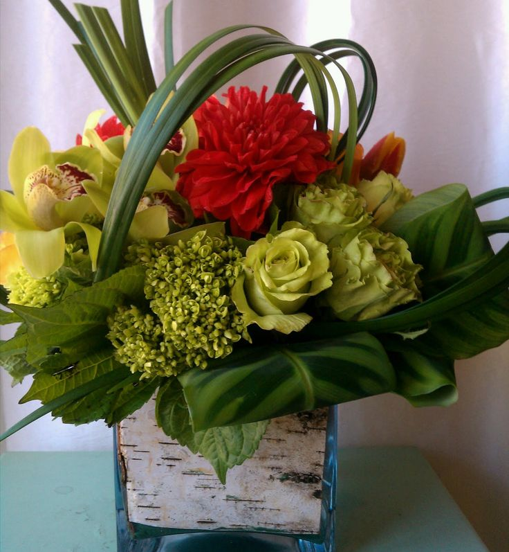you will understand the elements of design as well as the mechanic of arranging flowers in a vase basket to a hand held bouquet for every occasion - Floral Design Ideas