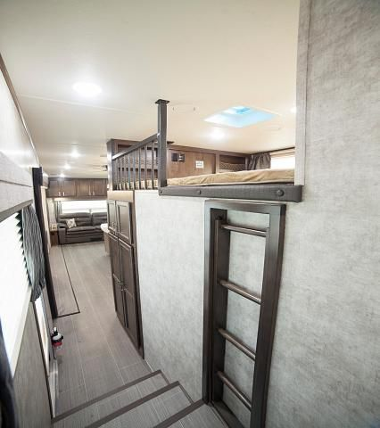 2017 Open Range Roamer 371MBH 5th Wheel with Loft and 2nd Bedroom.This is a new 5th Wheel floor plan from Open Range RV and it is sure to be a popular one! The 371MBH has rear entertainment that includes a Trifold sofa and theater seating both of which allow you to easily view the location of the TV that is located directly above the fireplace. The kitchen has a free standing table and chairs, a 3 burner stovetop with oven, a huge refrigerator, and a spacious pantry.