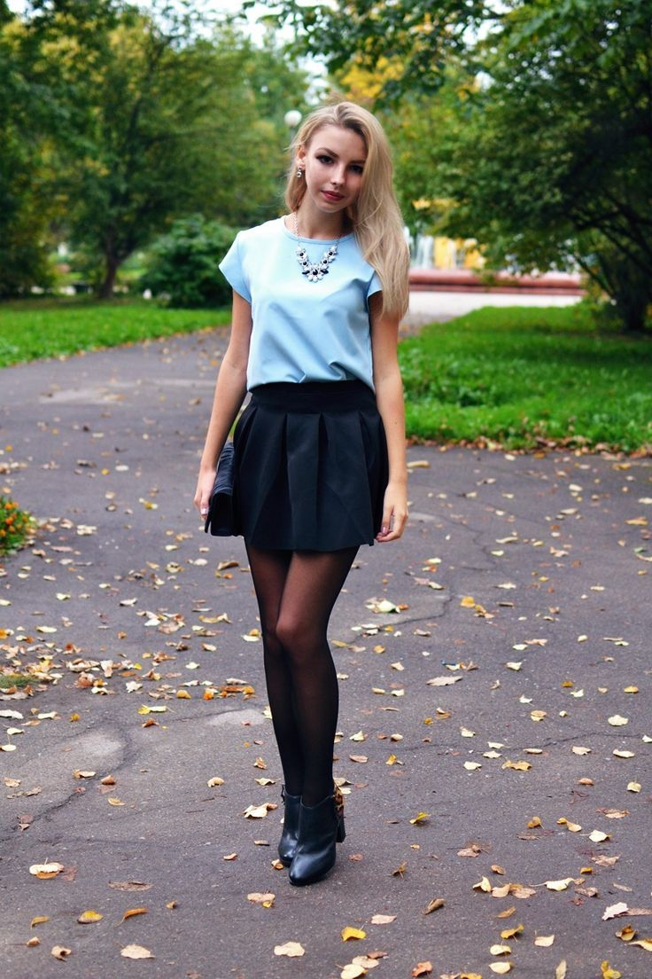 Shop this look on Lookastic:  http://lookastic.com/women/looks/short-sleeve-blouse-mini-skirt-ankle-boots-necklace-clutch/7340  — Light Blue Short Sleeve Blouse  — Black Pleated Mini Skirt  — Black Leather Ankle Boots  — White and Black Necklace  — Black Satin Clutch