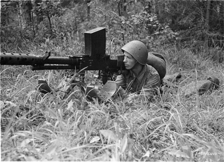 31 Unique World War Two Pictures from the Finnish Wartime Photograph Archive... In this photo taken on August 2, 1941, a Finnish solider looks down the sights of a 20mm Lahti L-39 anti-tank rifle.