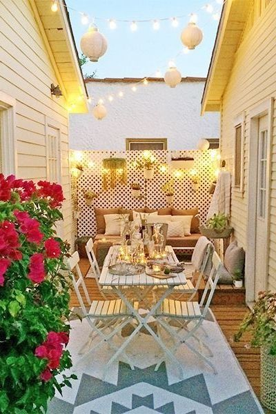 Trellis strung with lighting - 17 tips for making the most of your small space.