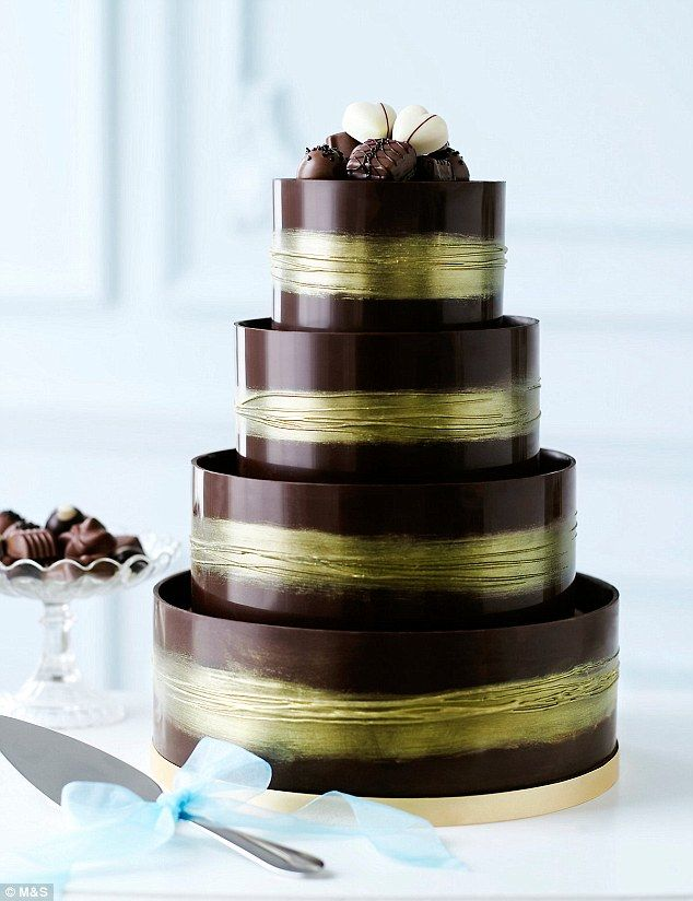 M&S's shimmering hoop chocolate wedding cake, £249, is filled and topped with chocolate ga...
