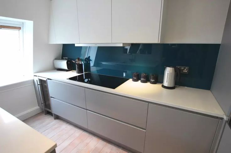 Teal glass splashback