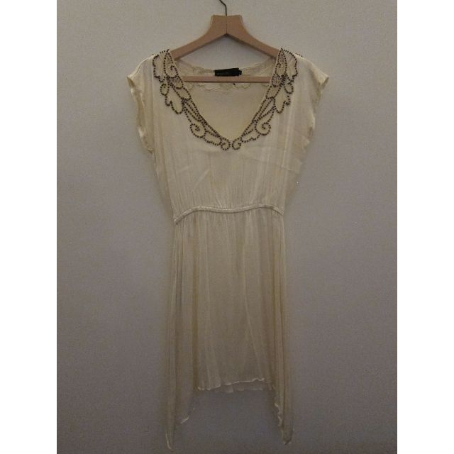 Beautiful Lightweight Dress with Bronze Beading Detail. Elastic Waist. Size 6 but will fit a small 8.100% Rayon. Excellent Condition.