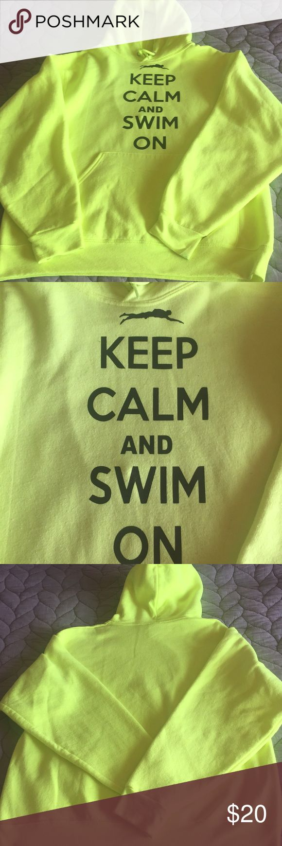 "Swim Hoodie ""Keep Calm And Swim On"" Hoodie . Perfect for the swimmer on swim team . Preloved. Has some piling. No holes, tears or stains. Neon yellow Tops Sweatshirts & Hoodies"