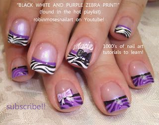 Zebra print nail art in purple, black, and white