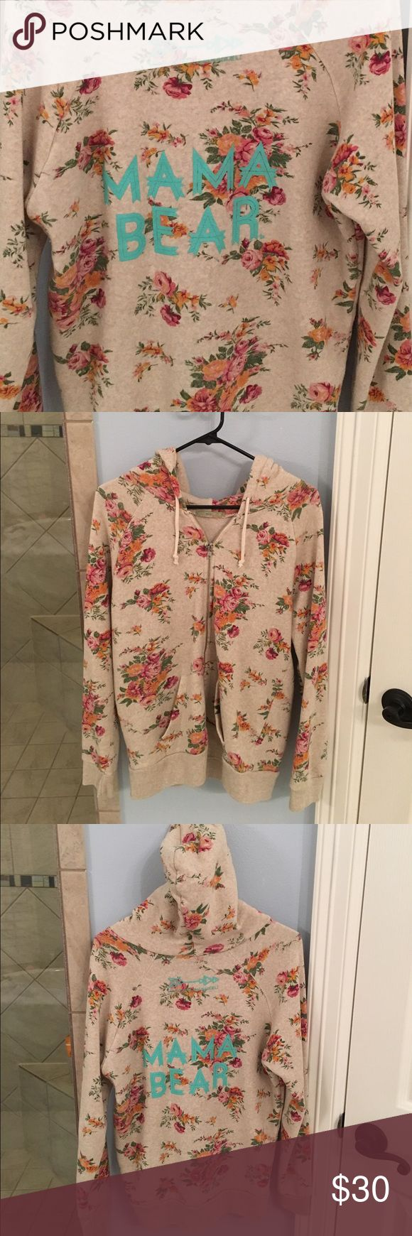 MAMA BEAR floral zip up hoodie *Loved by Hannah and Eli* collection. In great used condition. Signs of light wear only, no stains or tears. Floral zip hoodie with Mama Bear logo in turquoise on the back Loved by Hannah and Eli Tops Sweatshirts & Hoodies