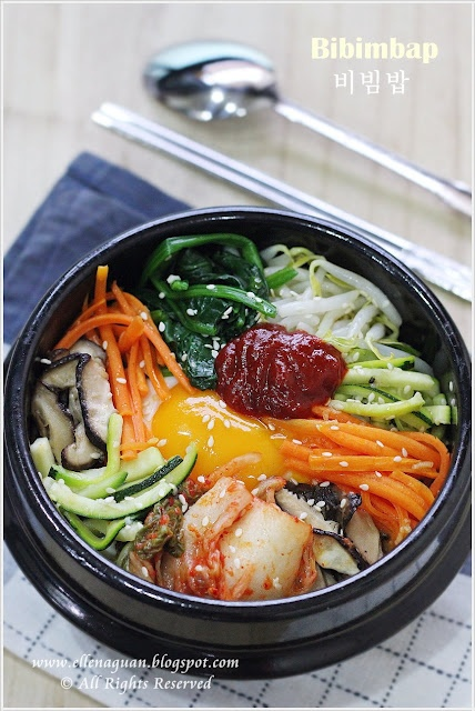 korean food: bibimbap ( 비빔밥). rice, mixed veggies, egg (sunny side up), and red bean paste. I'll have to make some minor changes