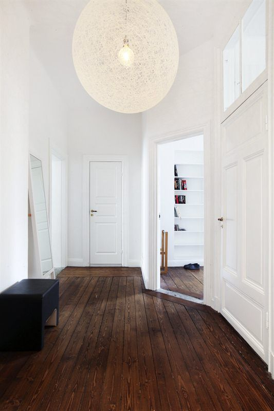 White door board for hall to kitchen! Note dark floors. Also light shade works well.