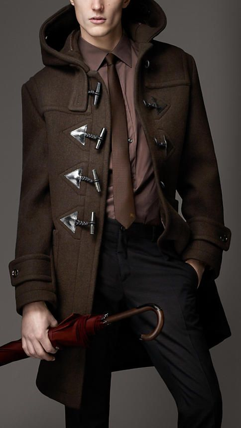 Shop this look on Lookastic: http://lookastic.com/men/looks/black-dress-pants-and-burgundy-dress-shirt-and-brown-tie-and-chocolate-duffle-coat/493 — Black Dress Pants — Burgundy Dress Shirt — Brown Tie — Dark Brown Duffle Coat