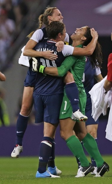 United States goalkeeper Hope Solo, right, celebrates with teammates winning the gold medal match against Japan at the 2012 Summer Olympics, Thursday, Aug. 9, 2012, in London. The U.S. women's football team won its third straight Olympic gold medal Thursday, beating Japan 2-1 in a rematch of last year's World Cup final and avenging the most painful loss in its history.