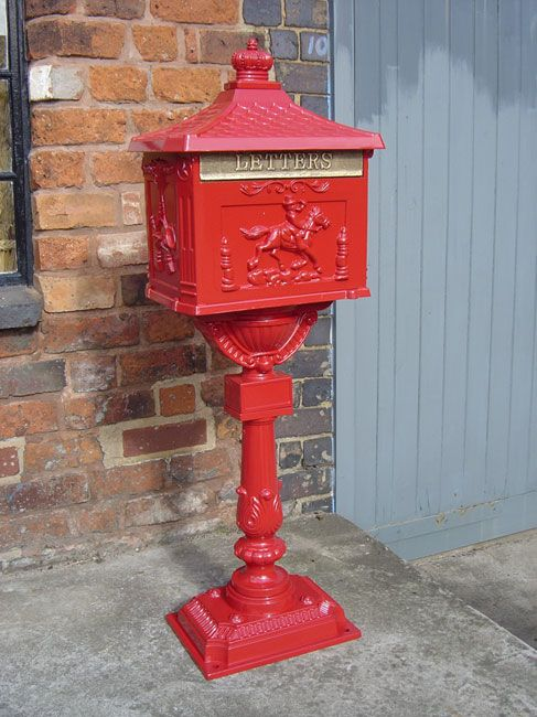 Red Free Standing Post Box - Free standing letterbox, for use at the end of the driveway or where there is no door facility. Box shape base with four fixing centres. Ornate stand with patterned post box depicting a horse and rider, sweeping into a domed top.