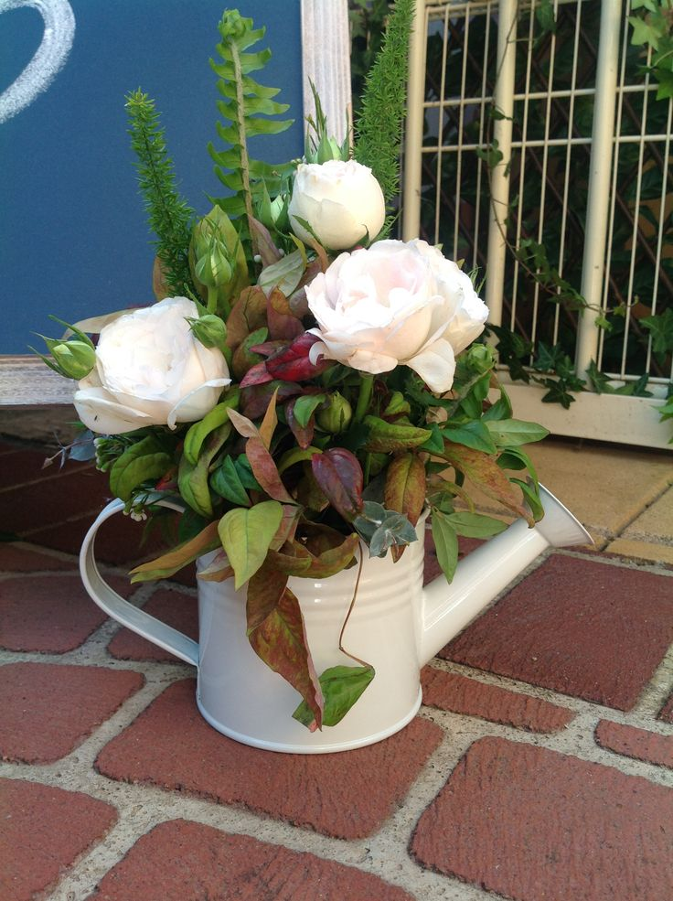 water can filled with fresh flowers www.houseofthebride.com.au