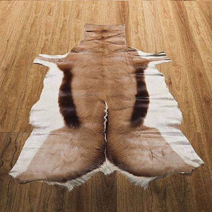 Introduce safari-chic style and animalistic power to your décor look with the realistic prints and colours of the Natural Springbok Animal Hide Rug from NSW Leather Co.