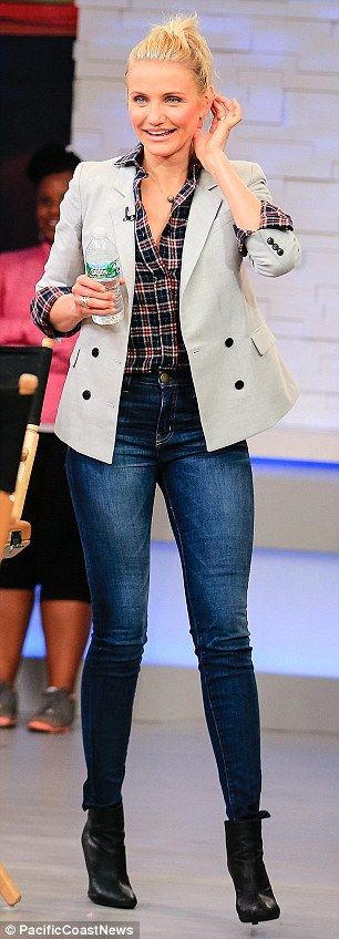 Walking advertisement: Cameron showed off her incredibly slender figure in hip-hugging high-waisted jeans
