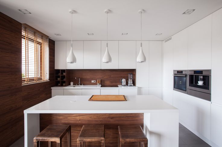 White is in! Designers are contrasting whites with dark wood for an interesting contrast #whiteandwood #interiortrend #hitrends