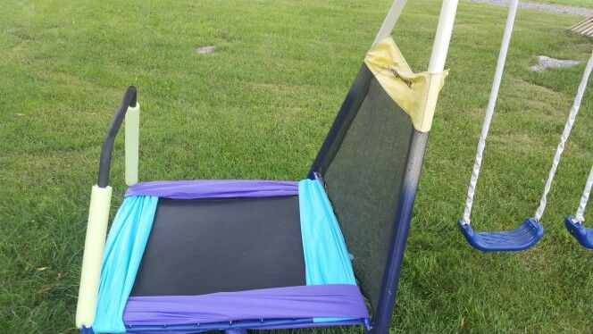 Diy spring and foot guard cover for small trampoline out of rectangular plastic table cloths. $1 each. Just tie together underneath