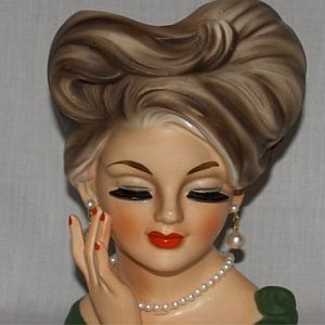 Google Image Result for http://www.queensofvintage.com/wp-content/uploads/2009/04/ladyhead.jpg