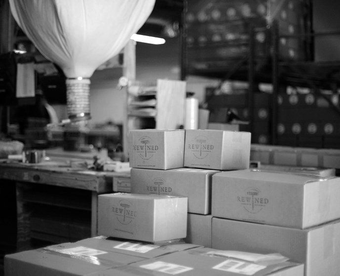Wrapped carefully, each candle is boxed and ready for a new home.
