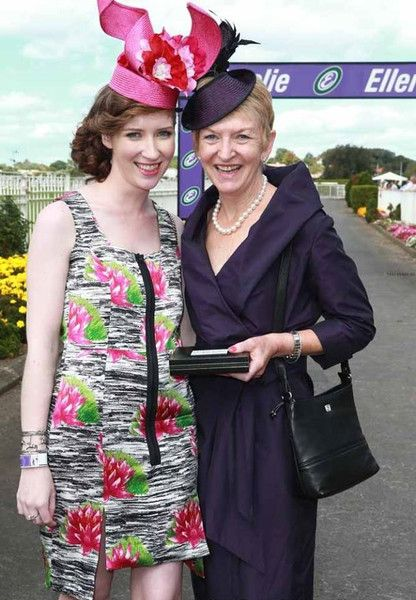 Elizabeth (left) wears a bespoke Natalie Chan headpiece