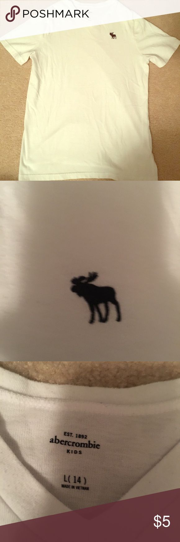 🆕abercrombie kids icon v-neck tee White abercrombie kids icon v-neck tee. Signature moose logo in navy. Some slight pilling.   ➳SAME OR NEXT DAY SHIPPING                                        ➳No trades, thank you!  ➳Make me an offer! ➳Lowballs declined ➳Ask questions BEFORE purchasing! abercrombie kids Shirts & Tops Tees - Short Sleeve