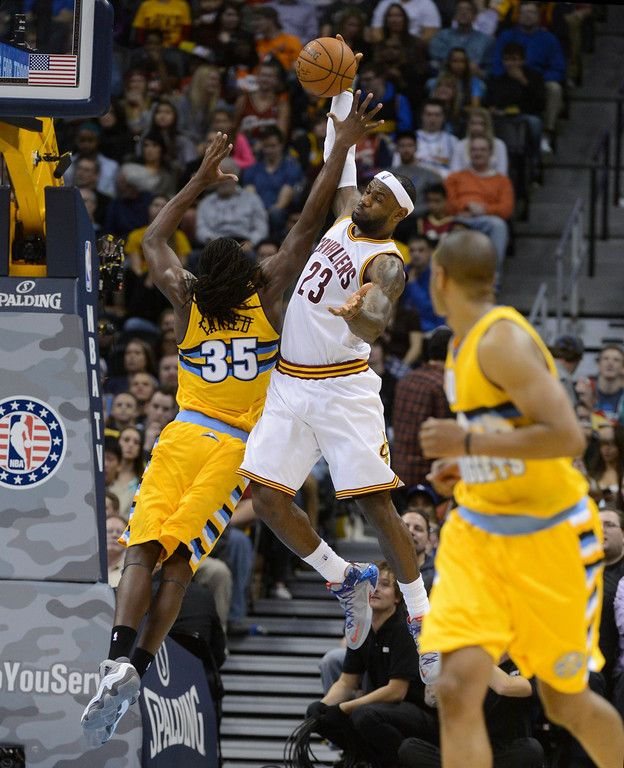 Description of . DENVER, CO - NOVEMBER 07: Cleveland Cavaliers forward LeBron James #23 and Denver Nuggets forward Kenneth Faried #35 go after a rebound in the third quarter Friday evening at the Pepsi Center November 07, 2014. (Photo by Andy Cross/The Denver Post)