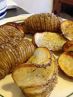 Slice whole potatoes almost all the way through, so that the slices are all still attached at the bottom of the potato. Drizzle with olive oil and your favorite potato seasonings, bake for about 40 minutes at 425