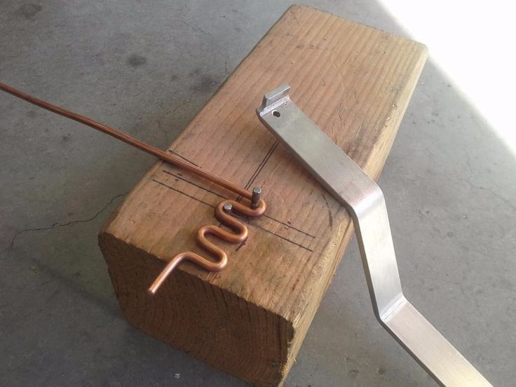 Wire Bender by dhem -- Homemade wire bender fashioned from wood and steel pins. http://www.homemadetools.net/homemade-wire-bender-2