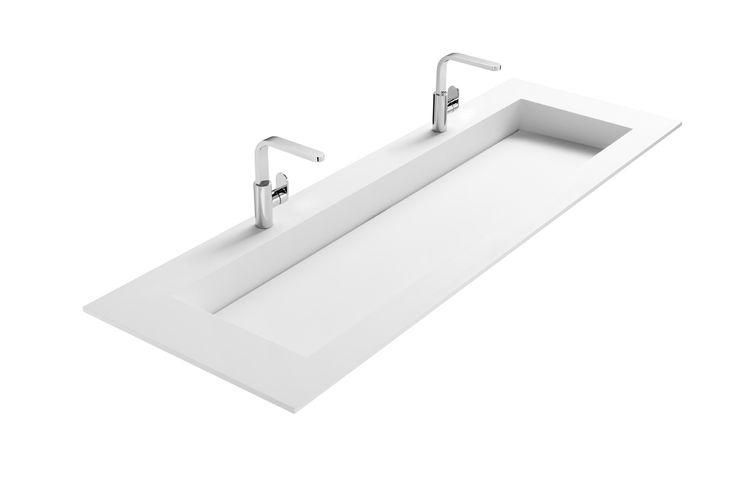Mat witte wastafel van Solid Surface. Wastafel is 160cm breed en kan met 2, 1 of geen kraangaten uitgevoerd worden. Combineer met badkamermeubel Frozen of Nuance!