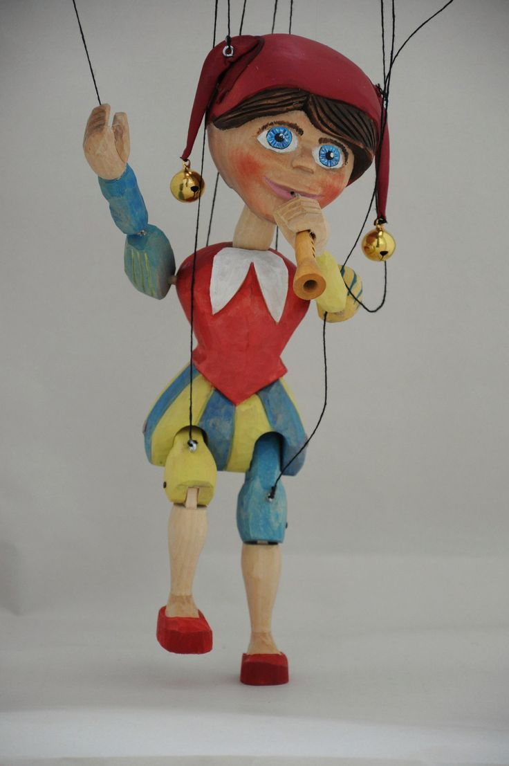 Jester with whistle made of basswood, height 35 cm. His head passes through a line that is attached to his left hand and to controller.