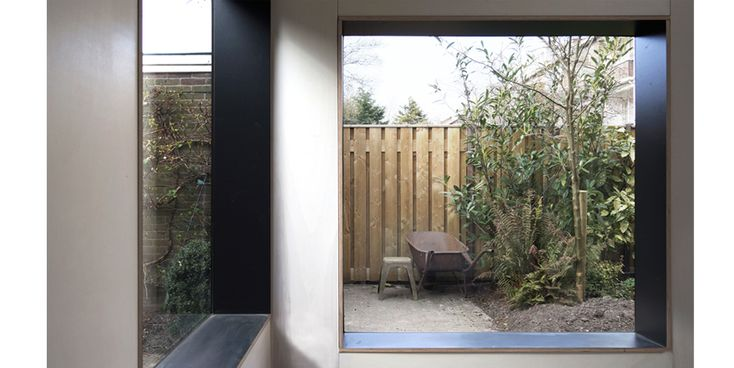 Interior of garden shed with frameless windows.
