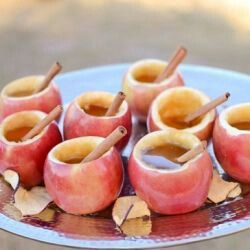 Great fall party idea. Core and fill with hot cider and then the guests can use to fill with ice cream scoop, hot caramel & nuts before eating the apple bowl / cup. Love it!