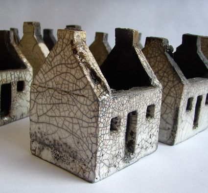 Ceramic houses of Rowena Brown, glazed and raku fired. Inspired by the abandoned dwellings on the islands of St. Kilda.