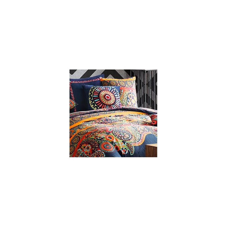 The Josie by Natori Hollywood Boho Comforter Set's eclectic design is unique and eye-catching. The comforter features a vibrant paisley and medallion print in bold shades of orange and citron on a navy blue ground and reverses to multiple floral prints. Made from 100% cotton and is machine washable for easy care.