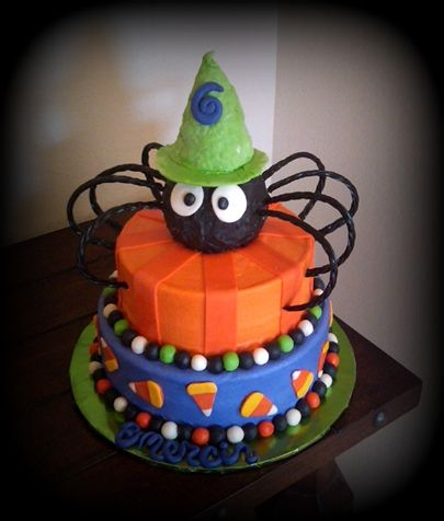 Halloween Spider Birthday Cake:   10, 8 orange pound cake with cream cheese filling, frosted in cream cheese bc, accented in fondant. Spider and hat are rice krispy treats dipped in chocolate, legs are black licorice.