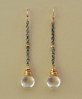 Handcrafted crystal quartz earrings delicately hand wrapped in 14kt gold fill wire and gently dangle from oxidized sterling silver chain.