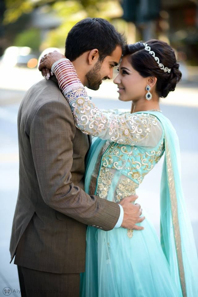 love her updo, the color of her lehenga, and the cute pose.  #shaadi
