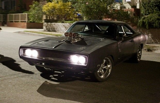 Fast & Furious (2009) Letty is surprising Dominic by restoring this wrecked 1970 Dodge Charger 2 piece by piece, and now we can see it restored to include a supercharged Chryster Hemi V-8 Holley fuel pump, Hedman headers, Flowmaster exhaust, Hotchkis suspension, Wilwood disc and slide brakes.