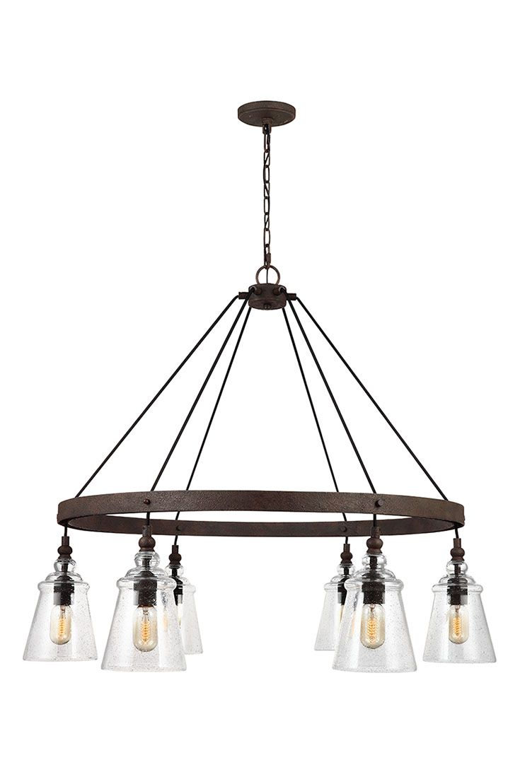 Loras 6 -Light Chandelier by Feiss: Contemporary take on historic, industrial designs. Feature multiple corded pendants beautifully suspended on to a Dark Weathered round Iron-finished frame. Clear seeded glass shades add more rustic charm to this traditional vintage-inspired silhouette, and the black fabric cord adds a clean, contemporary design. Through the clear glass shades, the exposed bulbs are central to the design theme. Perfect for your kitchen, dining room, or living room.