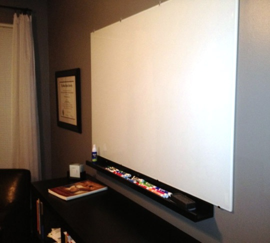 This whiteboard is actually the glass top to an IKEA dining room table.  Apparently, glass dry erase boards are really expensive, but just buying the glass top to the TORSBY (I love IKEA's names!) dining room table can be a cheaper substitute.  I love projects that repurpose an item, and inexpensive!