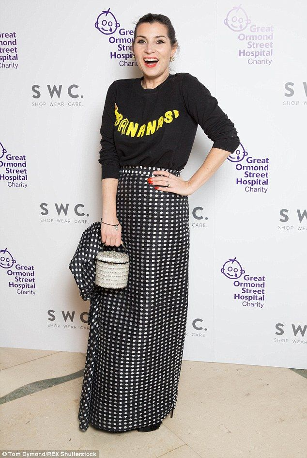 Quirky: Grace Woodward donned a black sweater with a polka-dot silk skirt and wicker baske...