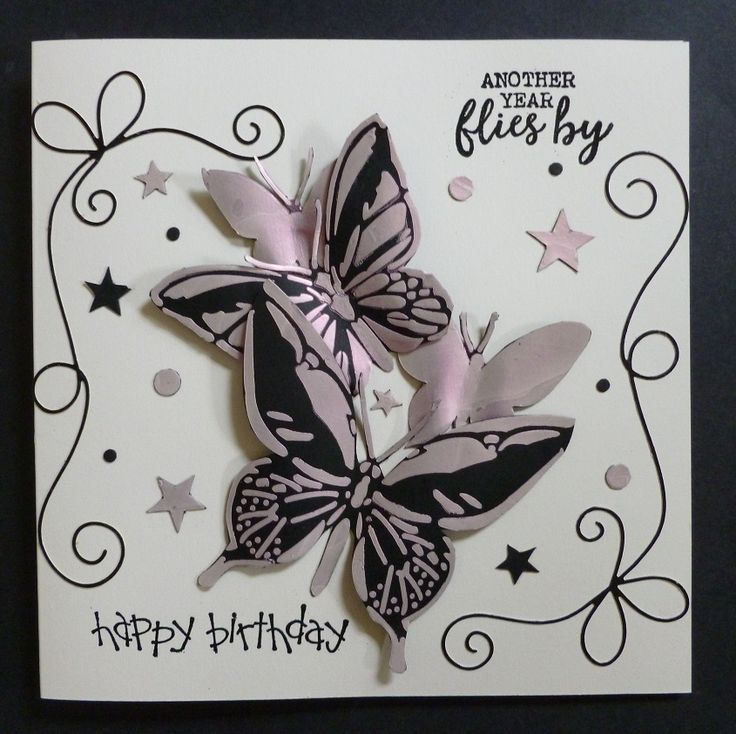 'Another Year Flies By' card -  Imagination Craft's - Mixed Media Art stencil butterflies no. AS-529.  Fabric Relief Paste-red.  Metal spatula.  Black shiny card.  Magi-bond glue.  Sentiment stamps from my stash.  Memory Box bow die.   June 2017.   Designed by Jennifer Johnston.