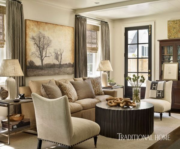 A large landscape painting by Atlanta artist Brett Deschene serves as the focal point of the family room. - Photo: Emily Jenkins Followill / Design: Courtney Giles