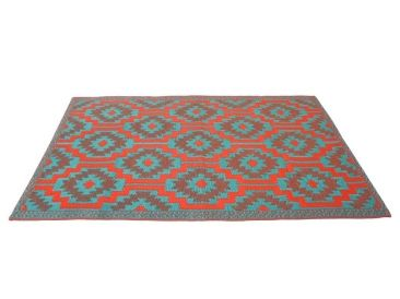 Outdoor Floor Mat Geo Red & Turquoise What a fantastic focalpoint feature for your backyard and garden. These outdoor & indoor rugs are great for a nap in the garden or to relax on the beach. Versatile rug which is great for kids & pets, and reversible. Outdoor mats are made from best possible, eco-friendly recycled polypropylene. Rugs are easy to clean and maintain, simply wipe with a wet cloth or dust with a cloth or duster