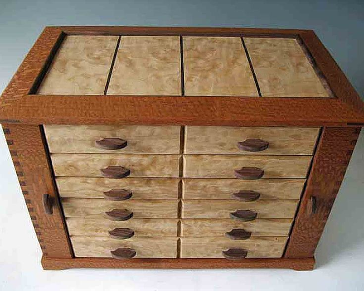 This gorgeous jewelry organizer handmade of exotic woods from around the world stores all of your jewelry in one place.