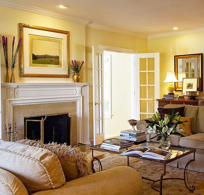 Comfortable Traditional Living Room Decor Featuring Hand Wrought Iron Coffee Table In Heavily Antiqued Gold Leaf Finish And Solid Cast Brass Fireplace