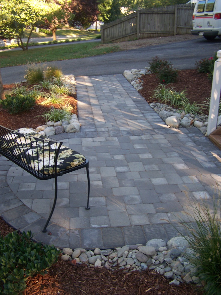 Clean, simple and a major upgrade.  A new front walkway will create a welcoming entry.      'Like' Outdoor Dreams on Facebook for access to our full portfolio and numerous articles to help maintain and  improve your landscape!    http://www.facebook.com/OutdoorDreams