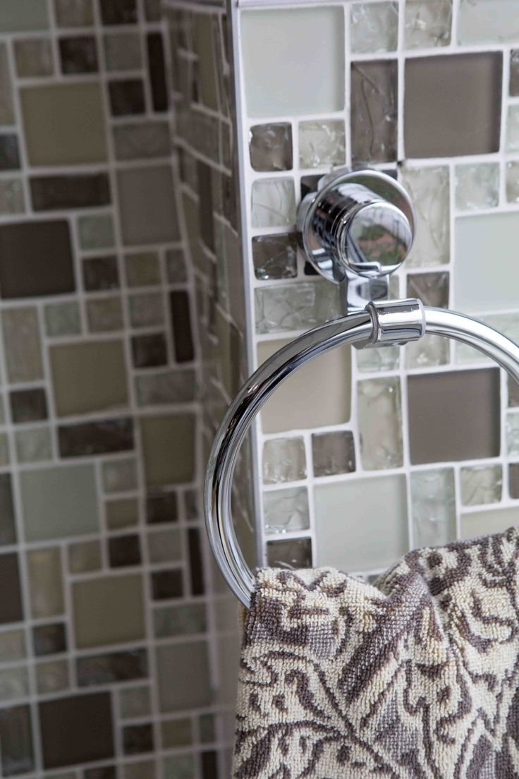 Shimmering glass #mosaics are perfect to add a burst of #colour behind the basin and in the shower