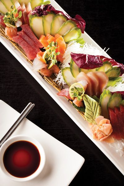 A collection of sashimi (salmon, tuna, white yellowtail, sea bass)